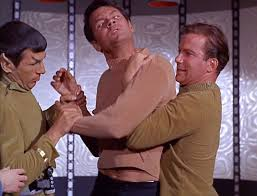 "Kirk (William Shatner) and Spock (Leonard Nimoy) attempt to restrain and increasingly dangerous Gary Mitchell (Gary Lockwood) in Star Trek's second pilot, ""Where No Man Has Gone Before""."